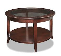 furniture round brown polished wooden coffee table with glass top and brown wooden board rack