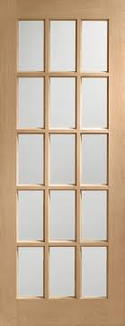 sa77 internal oak door with clear bevelled glass