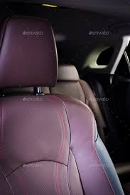 red perforated leather details luxury car interior stock photo images