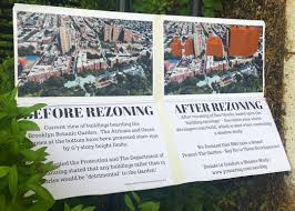 brooklyn anti gentrification network protest signs outside garden entrance ilrate the height of planned towers in