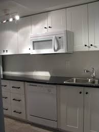 White Galaxy Granite Kitchen Kitchenette With Adel Off White Cabinets And India Black Galaxy
