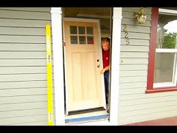 replacing a front doorHow to Install a SolidWood Exterior Door  YouTube
