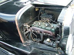 trembler coil ford model t engine the rectangular black box behind the engine contains the trembler coils