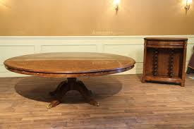 large round to round walnut dining table with buffet leaf storage