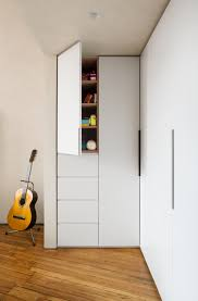 a trio of custom built in closets are installed under a sleep loft photograph