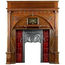 carved oak art nouveau antique fireplace mantel and integral cast iron insert for