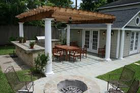 pergola kitchen. example of a classic backyard patio design in houston with fire pit and pergola kitchen