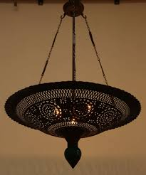 moroccan hanging chandelier handmade with nice intricate geometric fretwork cut out and a green ceramic