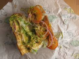 likewise the tomatoes red onions and lettuce added texture but not much in the way of flavor the bread was similarly plain and a lot like toasted sliced