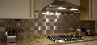 kitchen backsplash stainless steel tiles: interior modern kitchen decoration featuring stainless steel squared tile backsplash and yellow patterned marble