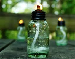 miniature mason jar citronella oil lamps for a cabin weekend getaway
