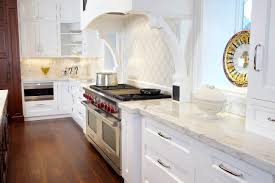 White Kitchen Cabinets Installed In The Kitchen With Marble