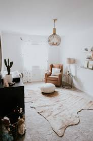 with the help of oilo studio this cowhide rug fit perfectly for grey s nursery i love how it adds an unexpected boho style to his nursery