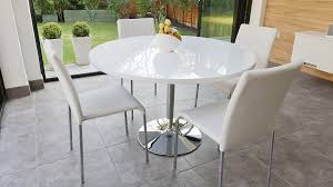 contemporary round white gloss dining table and white chairs