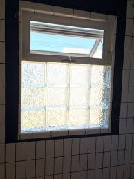 black and white bathroom remodel glass block with awning window