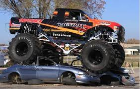 Watch an all-electric Bigfoot monster truck crush cars ...