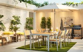 a large modern outdoor dining setting with two sets of sjÄlland tables and 4 chairs