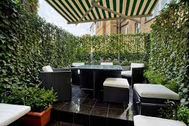 Kensington Vibrant green walls offer complete privacy in the roof garden of  this three-bedroom