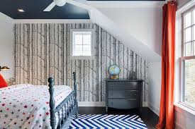 Blue And Orange Boyu0027s Bedroom Features A Navy Painted Ceiling Over A Navy 4  Poster Bed Dressed In Stars Bedding Atop A Blue Chevron Rug Facing A Window  ...