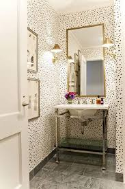 small powder room with wallpaper and console sink