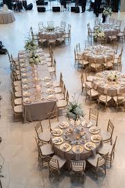 gold and white wedding reception table layout