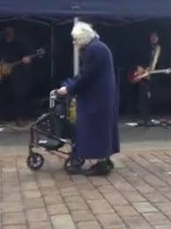 the gran walks past the local band badboys in paisley scotland