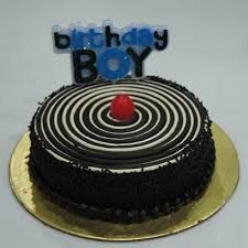 Send Chocolate Cake With Birthday Boy Candle Online Free Delivery