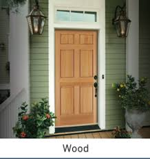 front door with window. Brown Wood Grain Door With A Top Window, On House Green Siding And Front Window