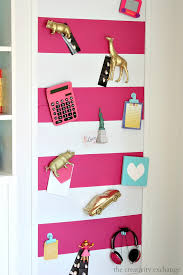 diy large magnetic board with spray painted toys for magnets