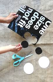 cut two circles from a piece of paper that has a lot of black on it each circle measures about 2 inches