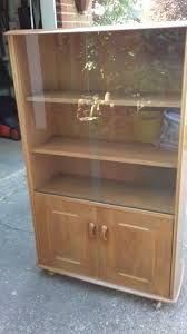 priory solid oak display cabinet bookcase with sliding glass doors cupboard below exc