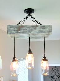 wagon wheel lighting fixtures mason jar lighting fixtures wagon wheel mason jar chandelier how to make