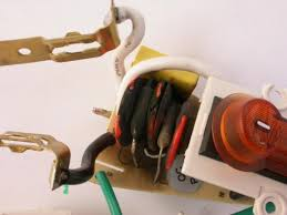 never use a surge protector a step down transformer innards of the surge protector charred varistor