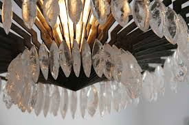 each chandelier has 108 rock crystal pendants the quality of the rock crystal and the work is exceptional on view at the gallery to be electrified with 1