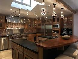 Track lighting in the kitchen Recessed Square Base Track Lighting Kitchen For Vaulted Ceiling With Skylight And Pendant Lamps Over Island Trainsrailways Square Base Track Lighting Kitchen For Vaulted Ceiling With Skylight