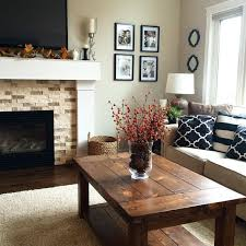 Understated Elegant Living Room In Neutral Shades Of Brown, Tan, Black And  White. White And Brick Fireplace. Striped And Graphic Patterned Throw  Pillows.