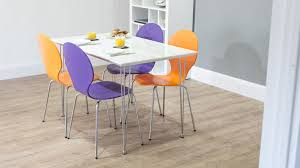 4 seater white gloss dining table and colourful dining chairs