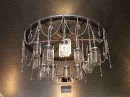 make your own wagon wheel chandelier western wedding verna and bobs weblog mason jar chandelier
