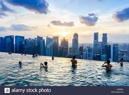 infinity pool singapore. Infinity Pool On The Roof Of Marina Bay Sands Hotel With Spectacular Views Over Singapore Skyline At Sunset,