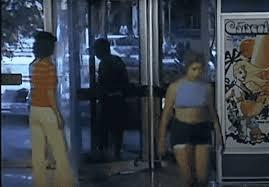 gif into glass door forever loop infinite purse fear of revolving doors girl walks