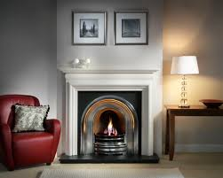 interior white fireplace mantel with shelf beside white lamp on the brown wooden table