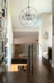 foyer chandelier ideas hall transitional with sloped ceiling framed art collage beige wall i