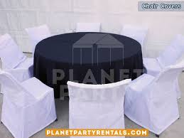 white chair covers with round table and black diamond runner