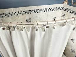 friendly bathroom makeovers ideas: tip  install a curved curtain rod