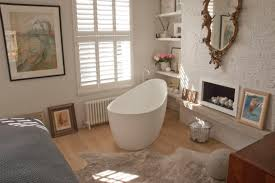 remarkable midcentury bathroom decors with oval soaking freestanding tubs added built in open shelves as well as wooden floors and bath mat ideas