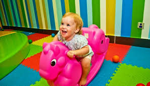 cute little girl on pink rocking horse toy which is one of the best toys for Best Toys For 1 Year Old Girls 2019 \u2022 Toy Review Experts