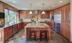 kitchen with beige granite counter raised stone tile floor