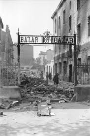 world war ii in europe view of the entrance to a marketplace reduced to rubble as a result of a german