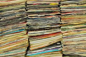 three stacks of old ic book magazines at a flea stock photo colourbox