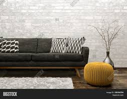 brick living room furniture. Modern Interior Of Living Room With Black Sofa Rug And Knitted Pouf Over White Brick Wall Furniture